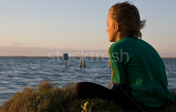 boy looking over lake Stock photo © clearviewstock