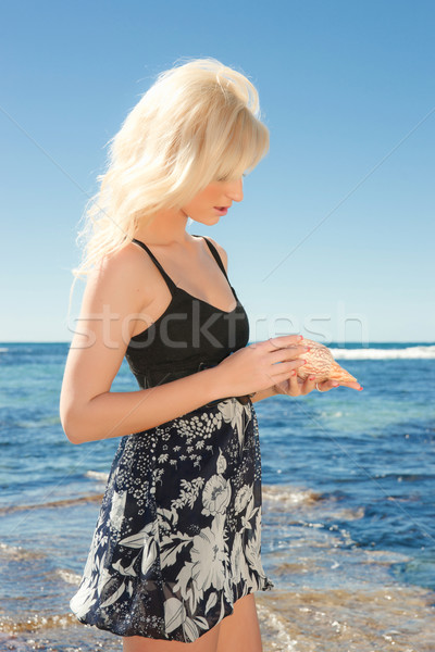 young woman on reef at sea Stock photo © clearviewstock