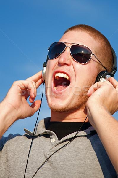 музыку наушники Cool молодым человеком человека Scream Сток-фото © cmcderm1