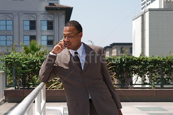 Fiatal üzletember sikeres erő öltöny épület Stock fotó © cmcderm1