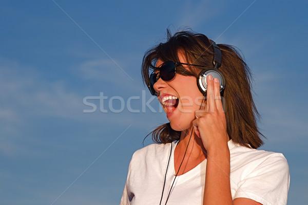 Música auriculares fresco jóvenes sonido Foto stock © cmcderm1