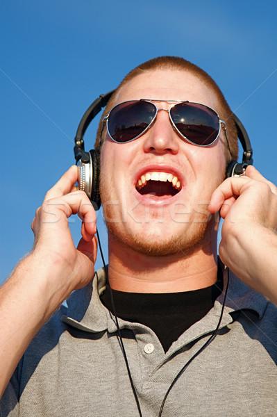 музыку наушники Cool молодым человеком улыбка человека Сток-фото © cmcderm1