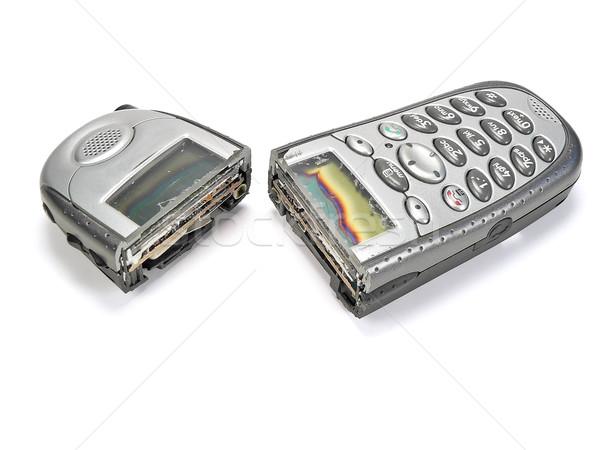 Celular cortar metade tela comunicação Foto stock © cmcderm1
