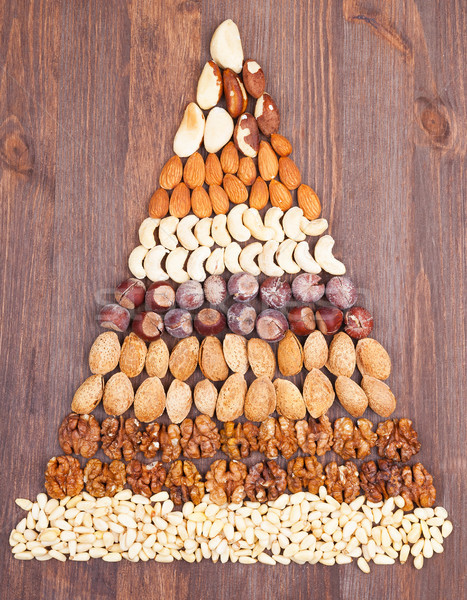 Nozes pirâmide forma madeira Foto stock © Coffeechocolates