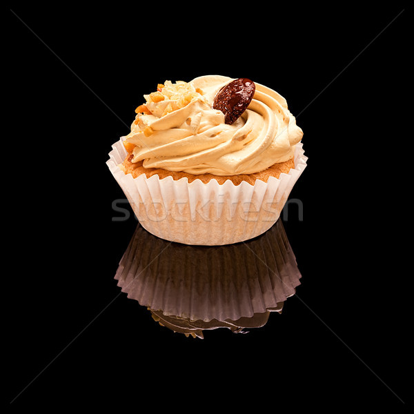 One muffin cupcake with coffee cream, chocolate and pieces of nuts Stock photo © Coffeechocolates