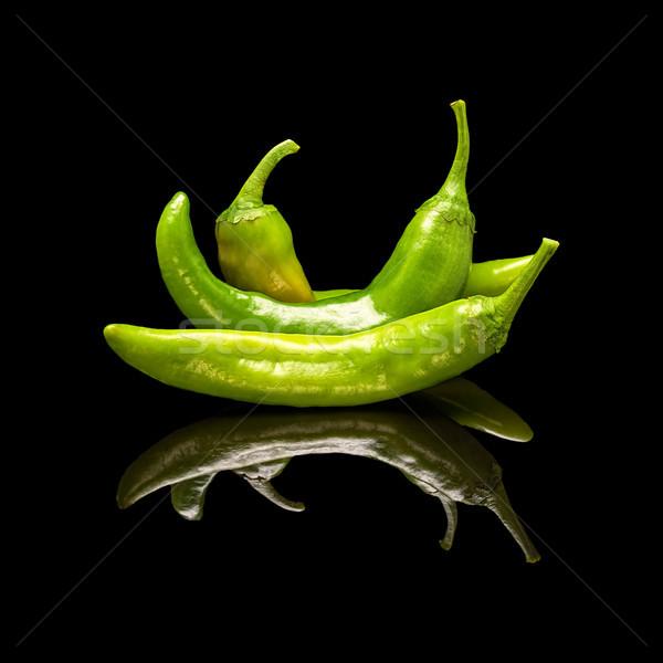 Three green hot peppers Stock photo © Coffeechocolates