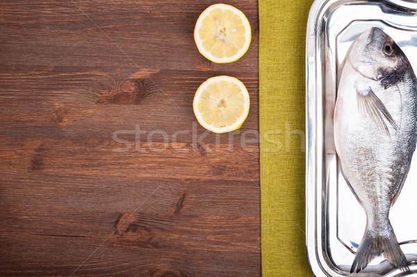 Peixe superfície fatias limão tabela Foto stock © Coffeechocolates