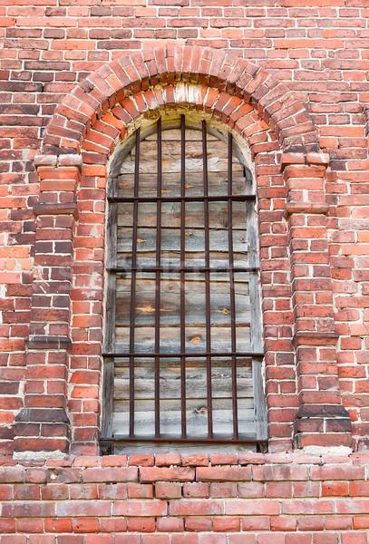 Window in an old brick church Stock photo © Coffeechocolates