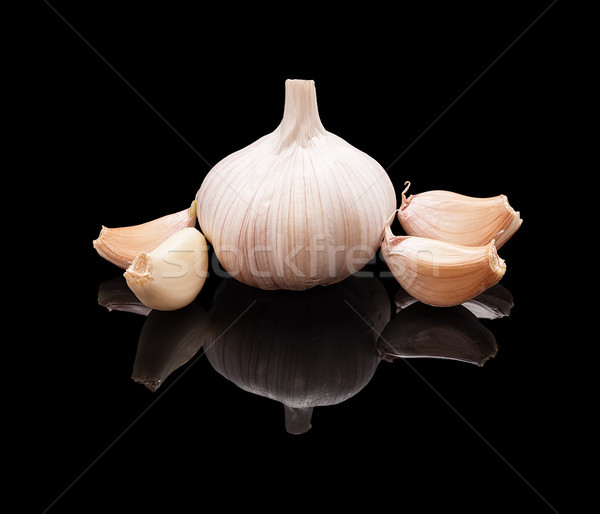 One unpeeled garlic with clove Stock photo © Coffeechocolates