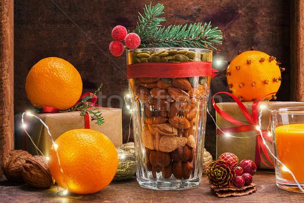 Vidro nozes caixas de presente laranja natal decoração Foto stock © Coffeechocolates