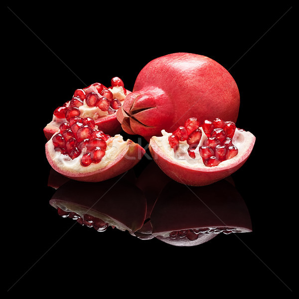 Pomegranate fruit with slices Stock photo © Coffeechocolates