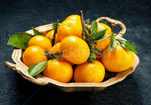 Tangerines on a round platter Stock photo © Coffeechocolates