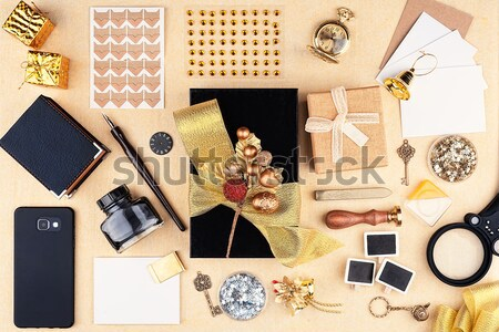 Cover of a closed leather notebook with office supplies and Christmas decorations Stock photo © Coffeechocolates