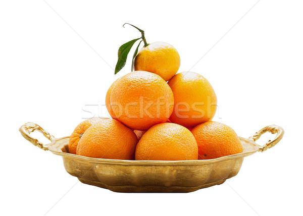 Oranges on a round platter isolated Stock photo © Coffeechocolates
