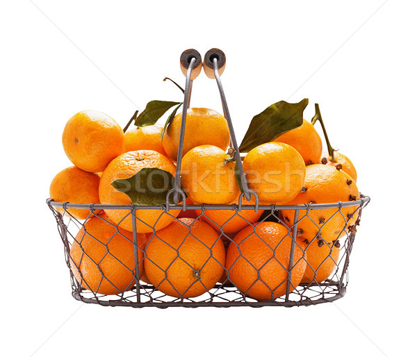 Oranges in metal wicker basket Stock photo © Coffeechocolates