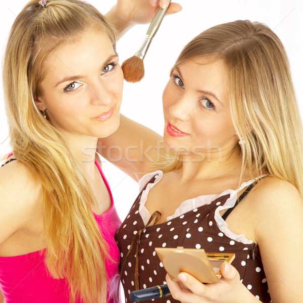 Stock photo: girls on a white background. Make-up.