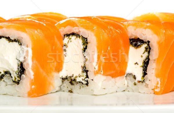 Sushi (Roll unagi maki syake) on a white background Stock photo © cookelma