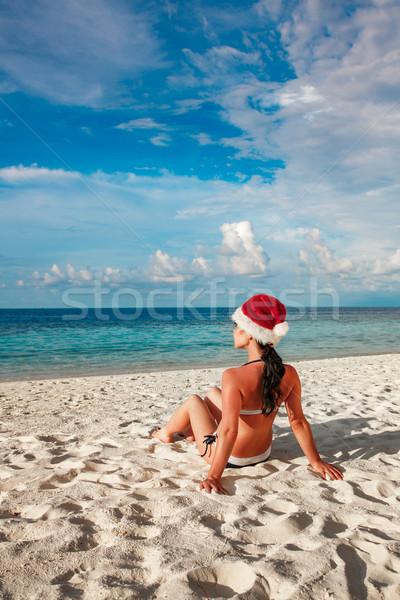 Woman in santa hat on the beach Stock photo © cookelma