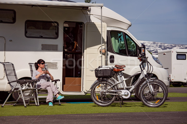 Woman is standing with a mug of coffee near the camper RV. Stock photo © cookelma