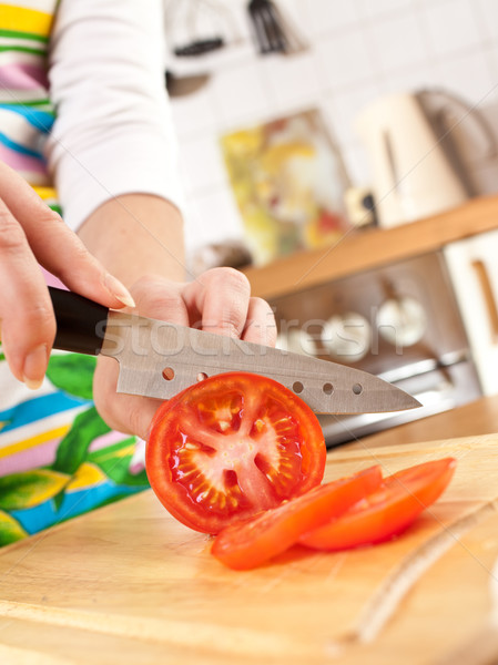 Woman's hands cutting tomato Stock photo © cookelma