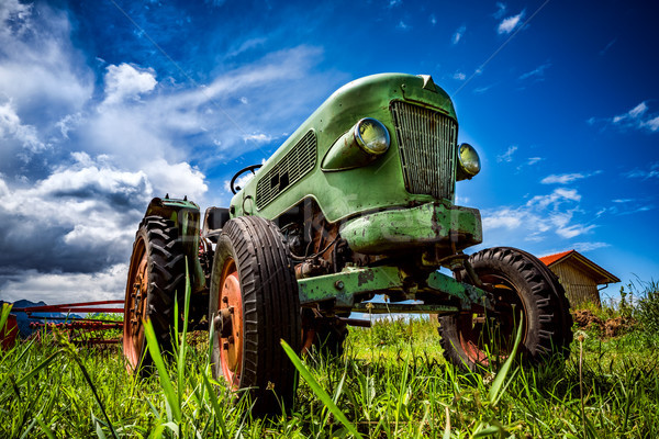 Old tractor in the Alpine meadows Stock photo © cookelma