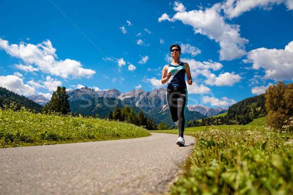 Woman jogging outdoors. Italy Dolomites Alps Stock photo © cookelma