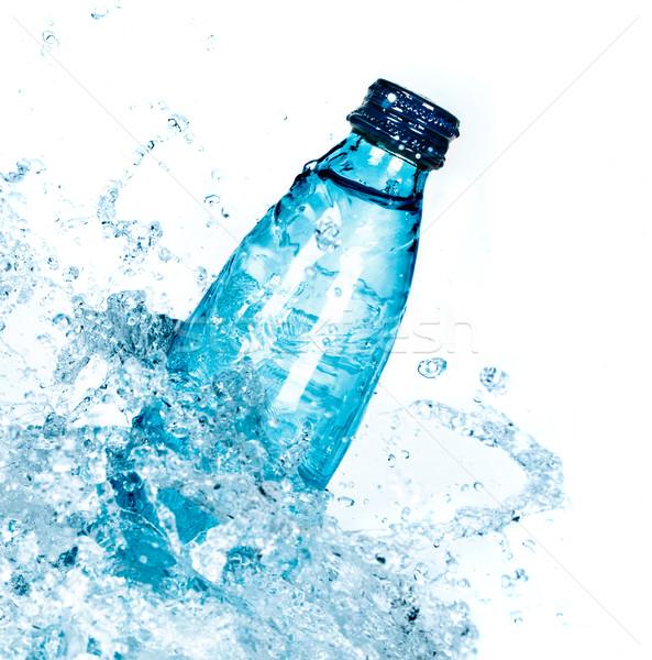 Bottle of water splash Stock photo © cookelma