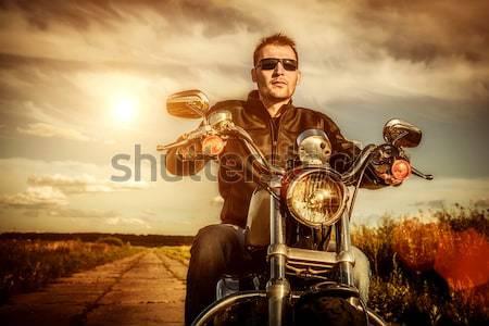 Menina motocicleta jaqueta de couro olhando pôr do sol Foto stock © cookelma