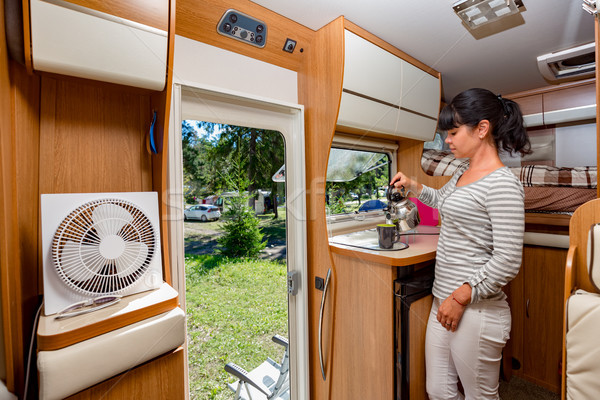 Woman cooking in camper, motorhome interior Stock photo © cookelma