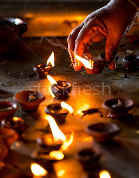 Burning candles in the Indian temple. Stock photo © cookelma