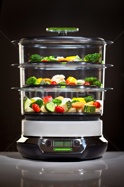 Healthy cooking, steam cooker with vegetables Stock photo © cookelma