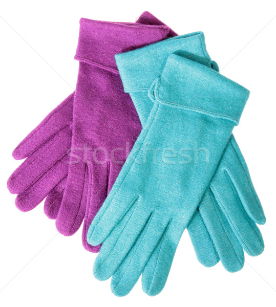 Multi-coloured woollen gloves on a white background Stock photo © cookelma