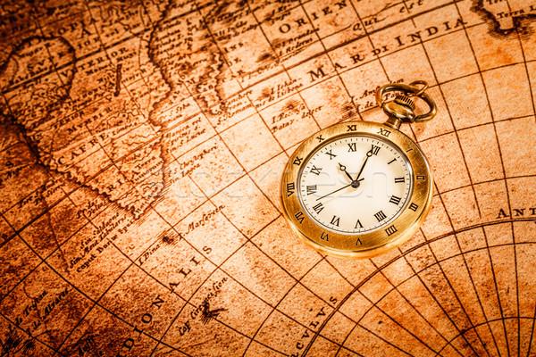 Vintage reloj de bolsillo antiguos mapa fondo tiempo Foto stock © cookelma