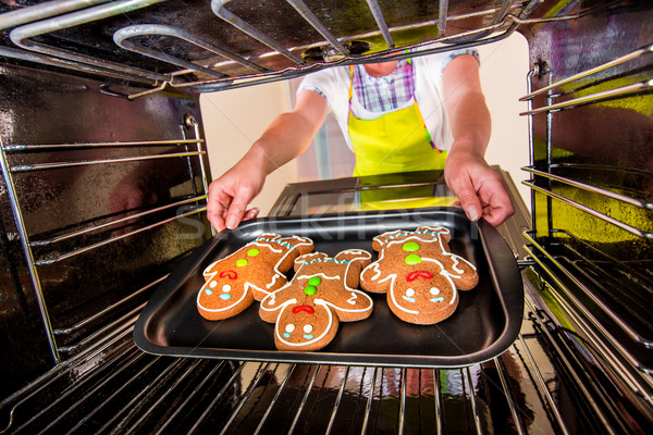 Baking Gingerbread man in the oven Stock photo © cookelma