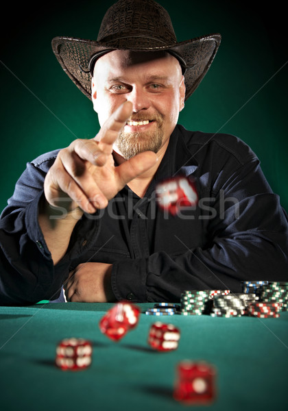 man throws dice on a green background Stock photo © cookelma