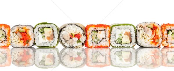 Sushi Roll on a white seamless background Stock photo © cookelma