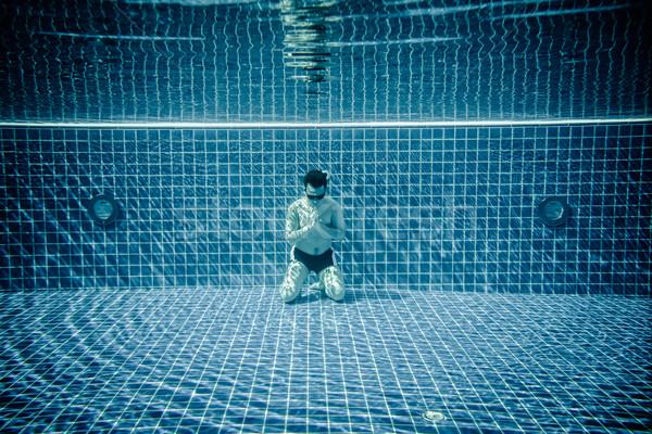 Férfi imádkozik víz medence vízalatti úszómedence Stock fotó © cookelma