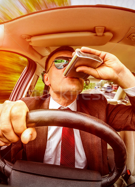 Drunk man driving a car vehicle. Stock photo © cookelma