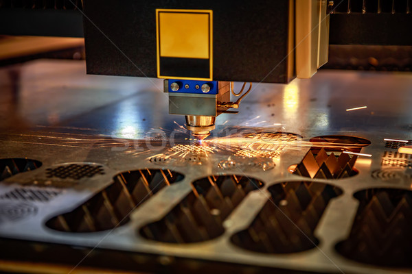 CNC Laser cutting of metal, modern industrial technology. . Stock photo © cookelma