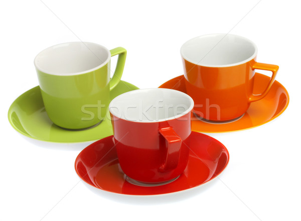 Three multi-coloured cups on a white background Stock photo © cookelma