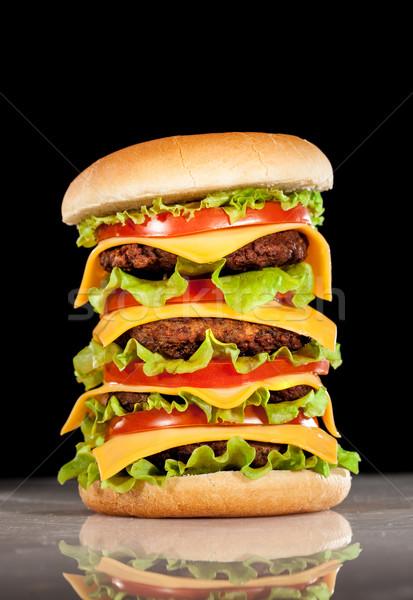 Lezzetli iştah açıcı hamburger karanlık bar peynir Stok fotoğraf © cookelma