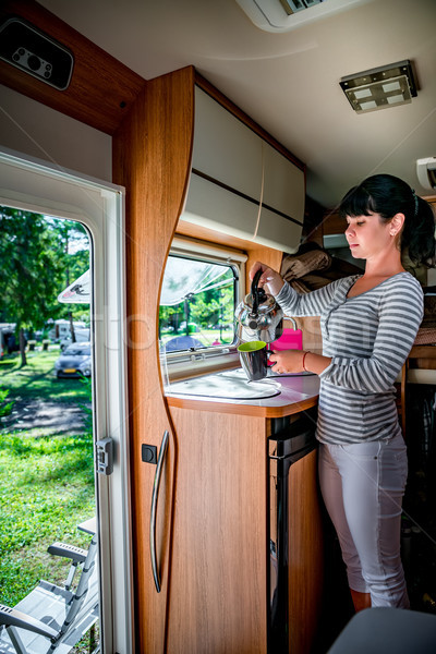 Woman cooking in camper, motorhome interior RV Stock photo © cookelma