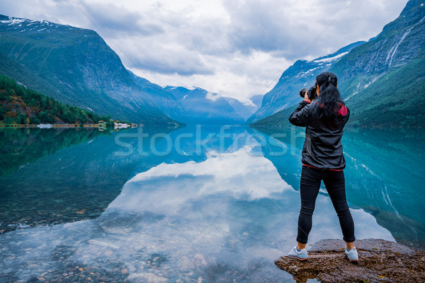 Nature photographer tourist with camera shoots lovatnet lake Bea Stock photo © cookelma