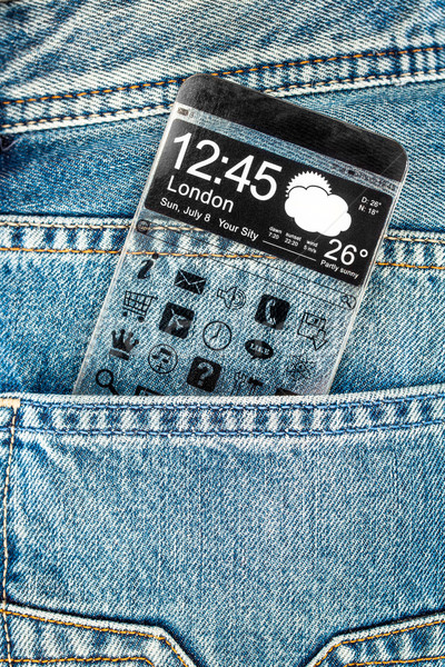 Smartphone with a transparent screen in a pocket of jeans. Stock photo © cookelma