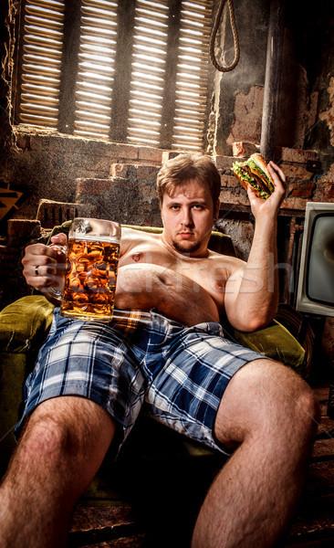 Kövér férfi eszik hamburger ül szék étel Stock fotó © cookelma