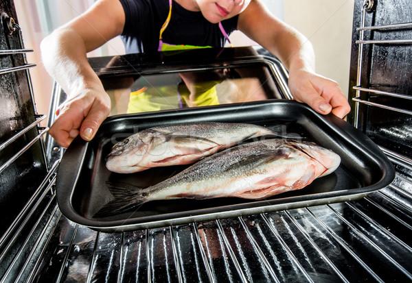 Cooking Dorado fish in the oven. Stock photo © cookelma