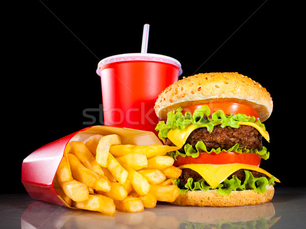 Tasty hamburger and french fries on a dark Stock photo © cookelma