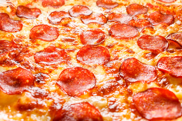 Pepperoni pizza primer plano apetitoso relleno marco Foto stock © cookelma