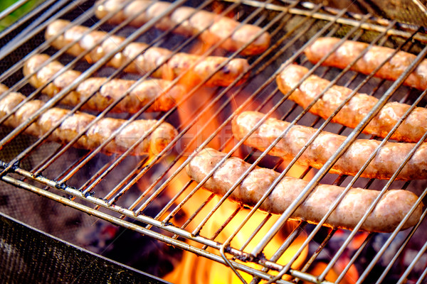 Grilling sausages Stock photo © cookelma