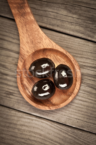 Olives on a wooden table Stock photo © cookelma